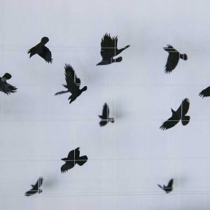 black and white sculpture of birds in flight