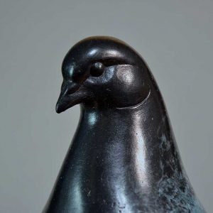 Close up of a sculpture of a pigeon's head