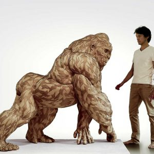 Lifesize gorilla sculpture with artist