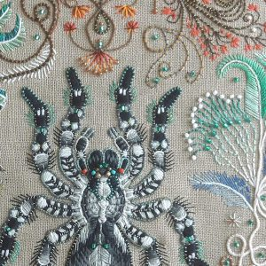 Close up photograph of an embroidered spider