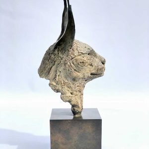 Side view of a bronze caracal head
