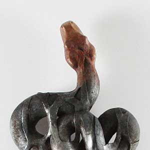 Close up of the head of a snake sculpted by Javier de la Rosa