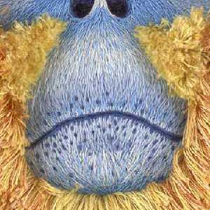 Blue embroidered mouth and nose of a primate