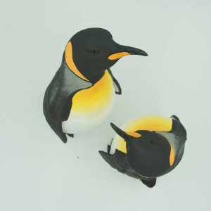 Overhead image of ceramic sculpture of two penguins