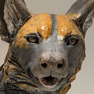Face of an African wild dog in ceramic