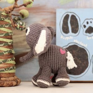 Handmade crocheted toy elephant with pink heart