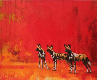 A mixed media painting on canvas of African wild dogs