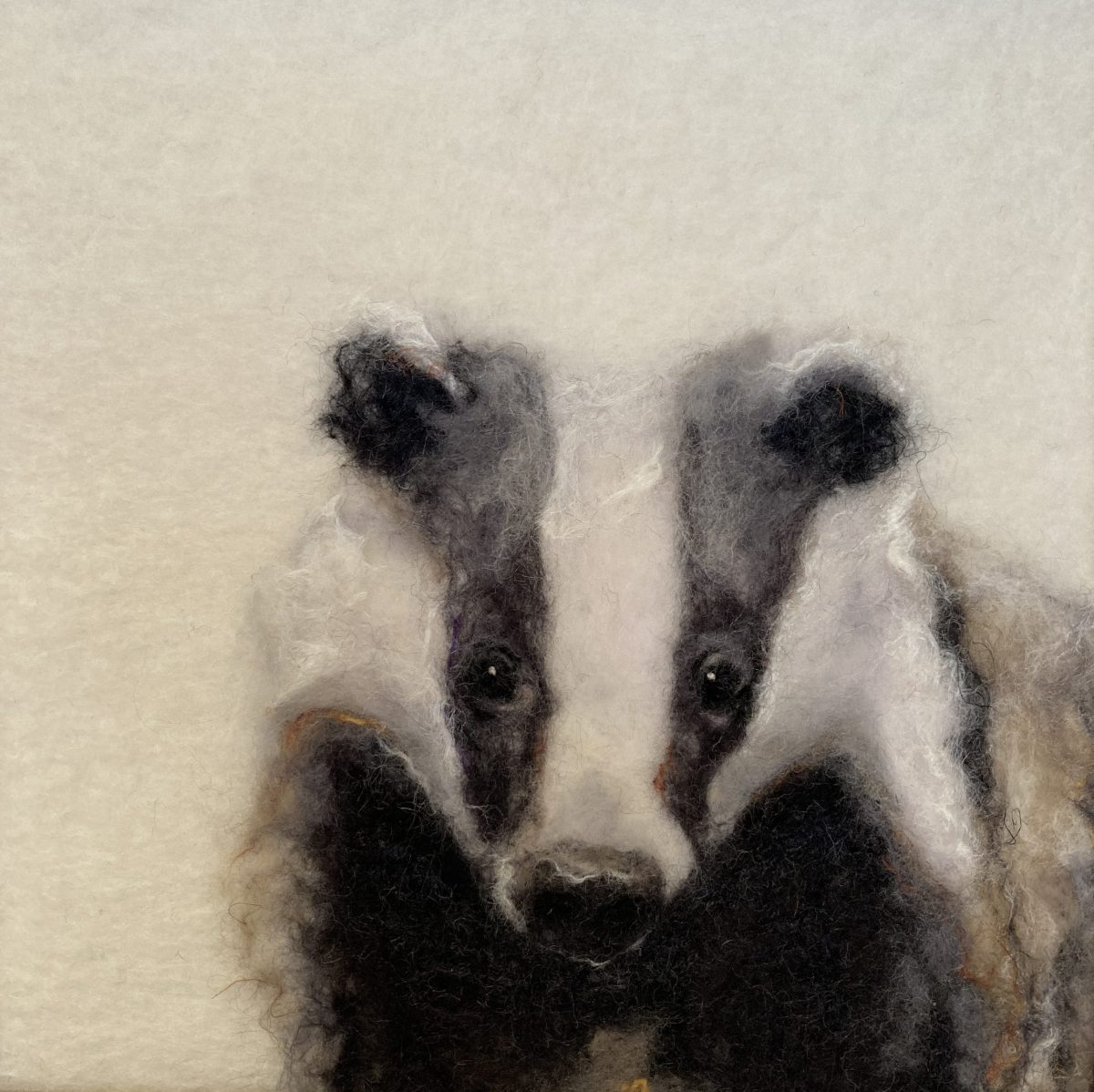 felt picture of a badger