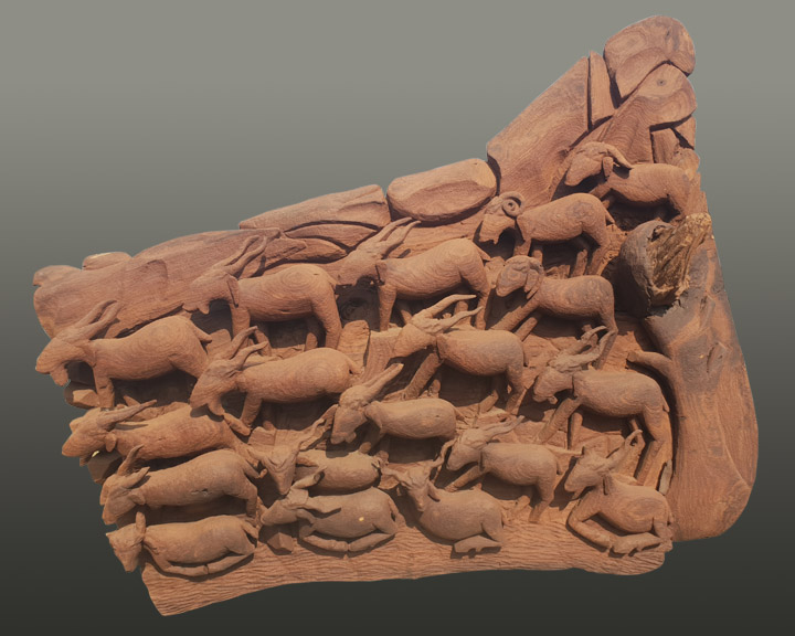 A sculpture of ibex carved out of wood