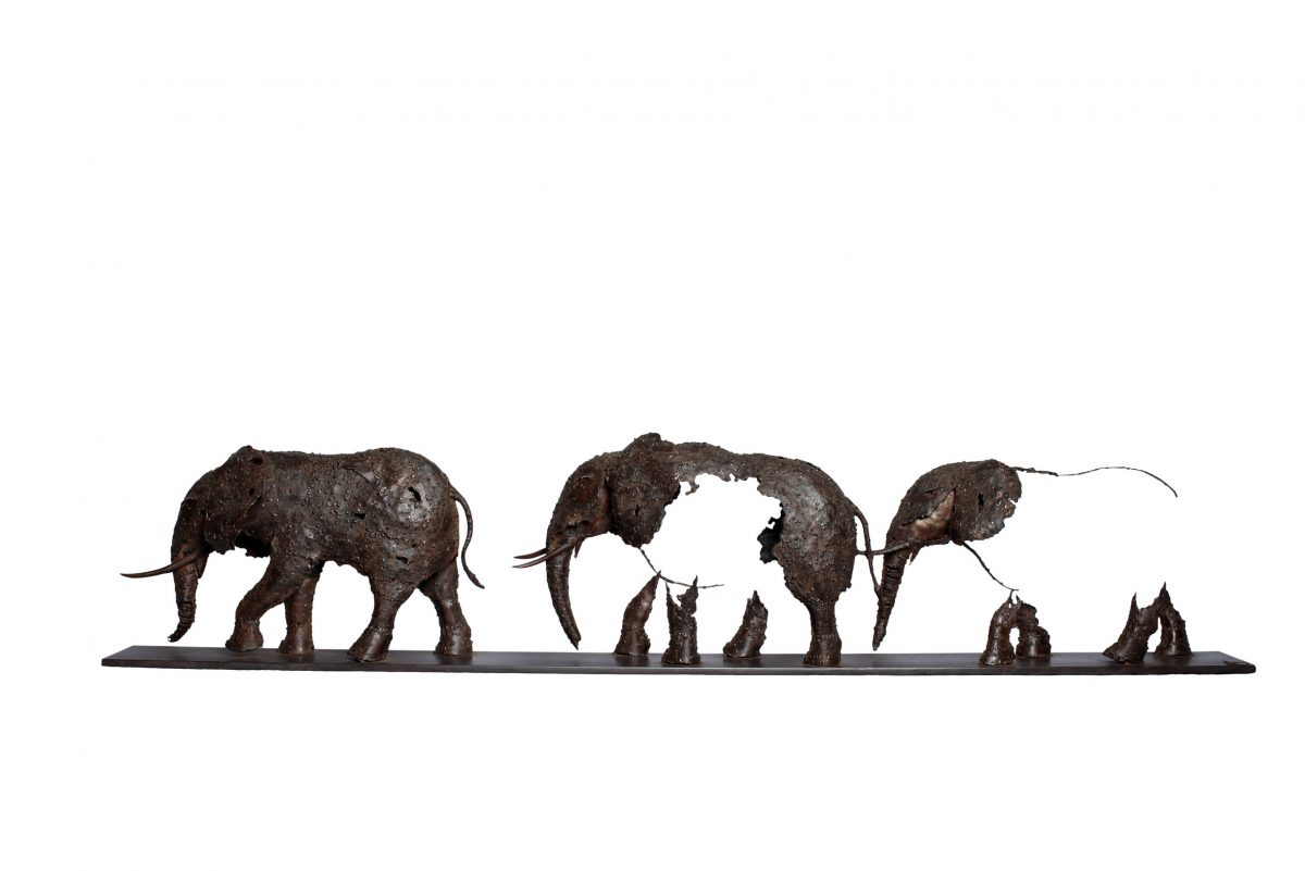A sculpture of elephants made from shaped, welded metal
